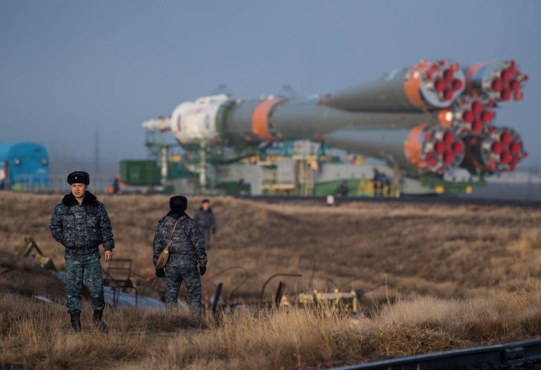 dc96f445 Security personnel are seen as the Soyuz rocket is rolled out by train to  the launch pad, Monday, March 19, 2018 at the Baikonur Cosmodrome in  Kazakhstan.