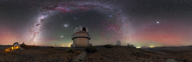 The Danish telescope at La Silla is framed by the Milky Way, with red and green airglow illuminating the horizon. Click for a zoomable image.