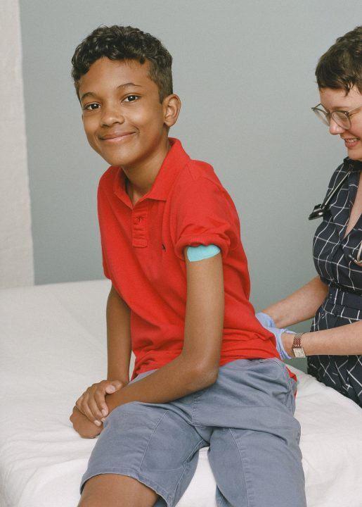 boy smiling after vaccination measles