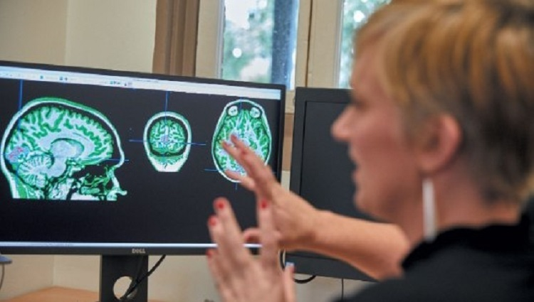 Kiley Seymour with brain scans neuroscience