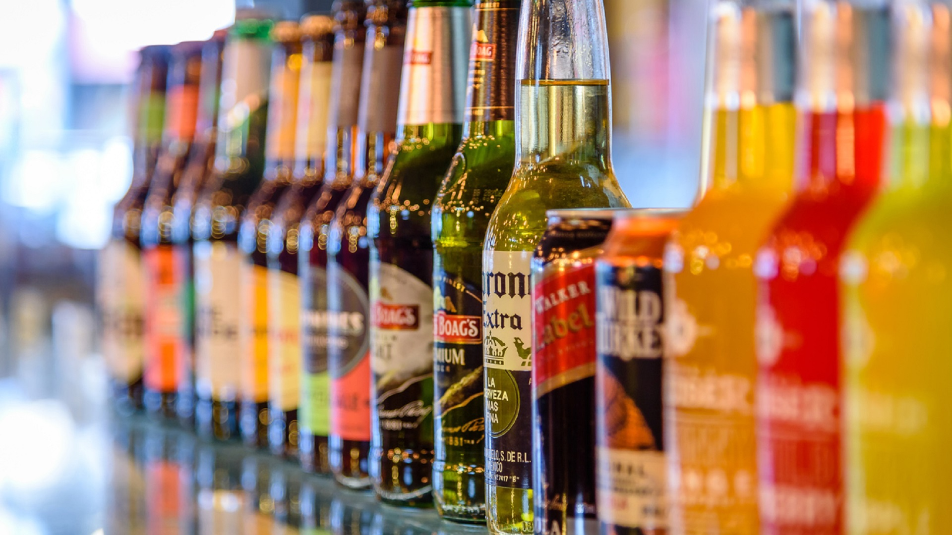 Lineup of beer bottles alcohol tax