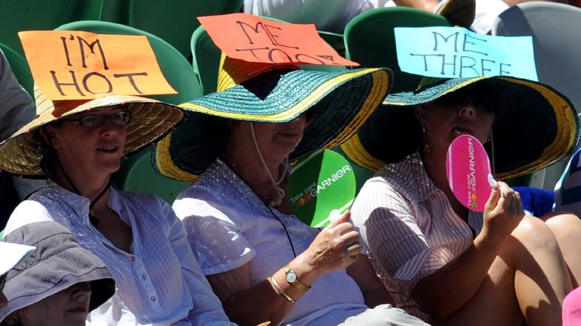 hot spectators wearing hats at tennis climate change global warming