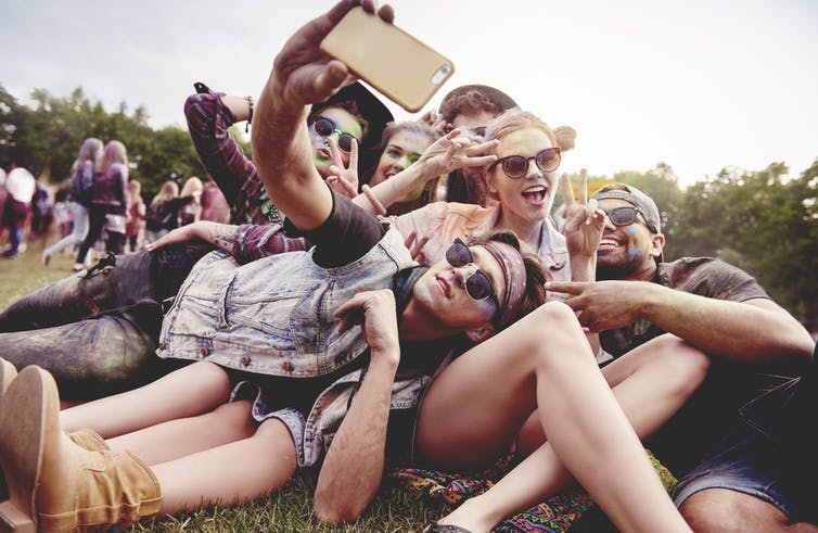 using illicit drugs_music festival_group of people